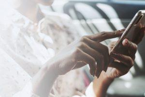 Woman using a phone in a car